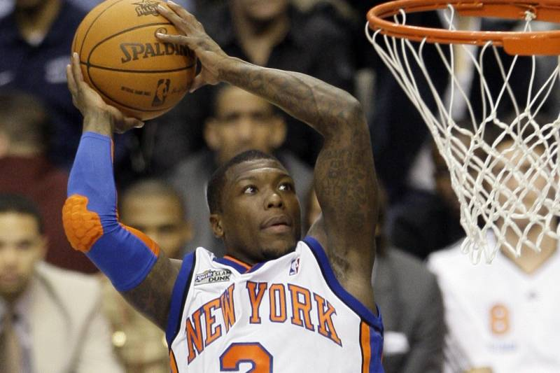 New York Knicks' Nate Robinson leaps during the slam dunk contest during the NBA basketball All-Star Saturday Night on Saturday, Feb. 13, 2010, in Dallas. (AP Photo/Tony Gutierrez)
