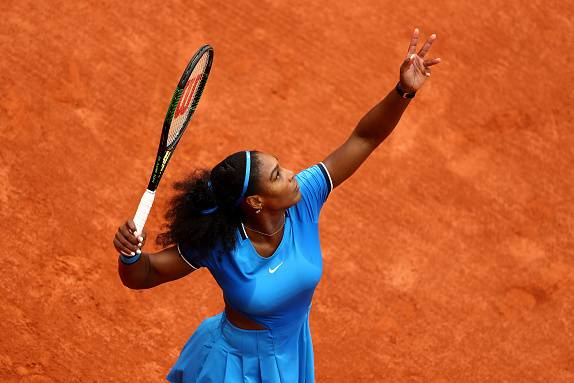 e120bd2cb Serena Williams serves during her second-round match at the 2016 French Open .