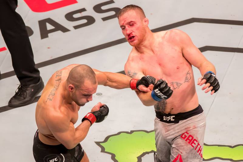 Justin Gaethje (right) hits Eddie Alvarez